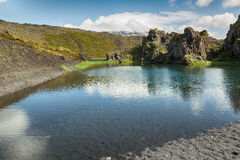 Lake and lava rocks in Iceland. Royalty Free Stock Images