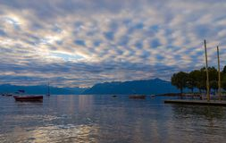Lake Leman, sunrise. Early morning, fantastic sunrise over the lake Leman with the beautiful multicolor sky. City of Lausanne, canton Vaud, Switzerland royalty free stock image