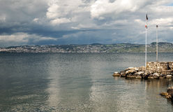 Lake Leman. In Switzerland Geneva city in the background on a cloudy day Stock Photography