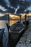 Lake Lesina and its sunset and boats Stock Images