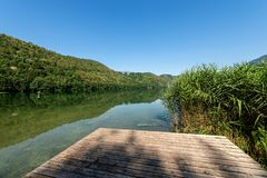 Lake of Levico - Trentino Alto Adige - Italy. Lago di Levico Lake with mountain and forest, Levico Terme, Italy, Europe stock photography