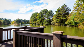 Lake Levy. Picture of a winding levy that overlooks a neighborhood lake Royalty Free Stock Photo