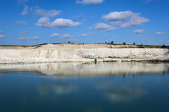 Lake in the limestone quarry. Royalty Free Stock Photo