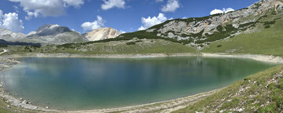Lake Limo, Dolomites - Italy. Relaxing view of the lake Limo, Dolomites - Italy royalty free stock photo