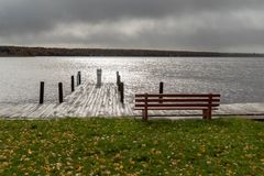 Lake Linden in Upper Peninsula of Michigan on a stormy day overlooking boat dock and park bench. Wonderful travel destination is Lake Linden in Upper Peninsula royalty free stock photos