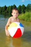 The lake a little boy playing with an inflatable ball Stock Photo