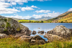 Lake Llynnau Mymbyr in Snowdonia, North Wales. View of Snowdon peak from lake Llynnau Mymbyr in Snowdonia National Park, North Wales Royalty Free Stock Image