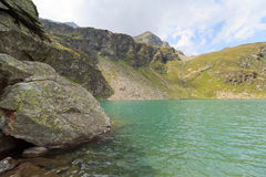 Lake Lobbensee and mountain Wildenkogel in Hohe Tauern Alps Royalty Free Stock Image