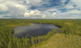 Lake and logging forest. Small lake in Finland. At the lake is forest with logging area Royalty Free Stock Images