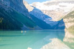 Lake louise canoas with tourists in summer stock images