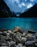 Lake Louise in Canada. Lake louise with rocks in the foreground Stock Images