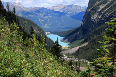 Lake Louise and the Chateau Lake Louise seen from the Plain of the Six Glaciers hiking trail royalty free stock photos