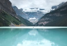 Lake Louise is full of red canoes in the summer royalty free stock photos