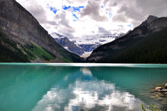 Lake Louise reflections. Fabulous colours of lake Louise and Rocky mountains reflected on blue water Stock Images