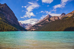 Lake Louise,  Rocky Mountains, pine forests and glaciers Stock Photography