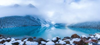 Lake Louise at Snow. The cloud towards to the mountains and let it go anywhere as long as cloud will be always there for you stock photo