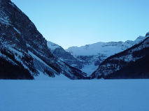 Lake Louise in Winter. Sunset over the frozen landscape of scenic Lake Louise in the Canadian Rockies Royalty Free Stock Image