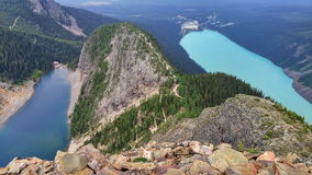 Lake Louise y lago mirror del pico del pulgar del diablo Foto de archivo libre de regalías