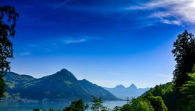 Lake Lucerne in Switserland with mountains and blue sky royalty free stock photography