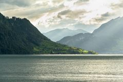 Lake Lucerne in the evening. View of lake Lucerne in the evening, as seen from Weggis, Switzerland. Mount Pilatus on the right Stock Photo