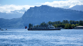 Lake Lucerne. A scenic view of Lake Lucerne crossed by a tourist boat Stock Photography