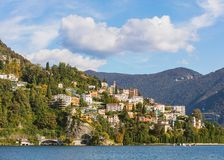 Lake Lugano and buildings on the foot of the Monte Bre mountain royalty free stock photography