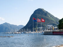 Lake Lugano, Monte San Salvatore ,and the flags of Switzerland, Royalty Free Stock Photography