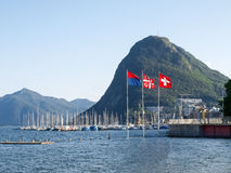 Lake Lugano, Monte San Salvatore ,and the flags of Switzerland, Royalty Free Stock Photo