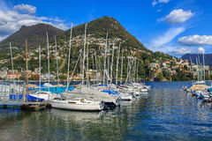 Lake Lugano in Switzerland. Lugano, Switzerland - 12 October, 2016: view on Lake Lugano, Monte Bre and Monte Boglia mountains in the background. Lake Lugano is a Royalty Free Stock Images