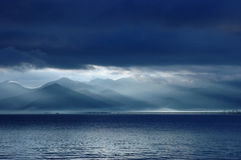 Lake lugu sunrise. A sunrise pic at lake lugu in a cloudy morning. take in yunnan after Royalty Free Stock Photo