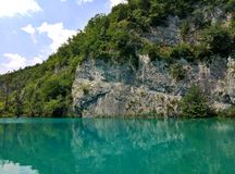 The lake with luminous azure-colored water. Greenery and rocks. Plitvice Lakes, Croatia stock images