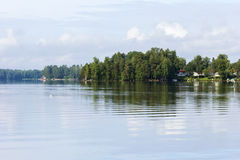 Lake, lush forest and a few houses in Finland Royalty Free Stock Image