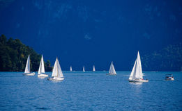 Lake Luzern. The lake is a complicated shape, with bends and arms reaching from the city of Lucerne into the mountains the sailing boats goes peaceably on the Stock Photo