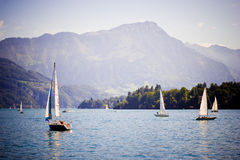 Lake in Luzern, Switzerland. An hour south of Basel and Zürich, and boasting invigorating mountain views, lake cruises and a picturesque old quarter, LUZERN ( Stock Photos