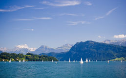 Lake in Luzern, Switzerland. An hour south of Basel and Zürich, and boasting invigorating mountain views, lake cruises and a picturesque old quarter, LUZERN ( Royalty Free Stock Photography