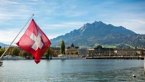 Lake Luzern in Switzerland. The view of Lake Luzern in Switzerland and the swiss flag Royalty Free Stock Image