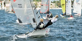 Children sailing competition in dinghies. royalty free stock images