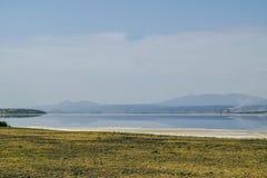 Lake against an arid landscape. Lake Magadi against an arid landscape, Magadi, Rift Valley, Kenya  safari travel scenic beautiful nature natural dry desert royalty free stock photo