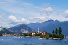 Lake Maggiore. Panorama of Lake Maggiore and Fishermen Island with Alps mountains in background, Piedmont, Italy Royalty Free Stock Photo