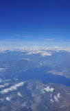 Lake Maggiore, monte rosa and the alpine range air view Royalty Free Stock Photos