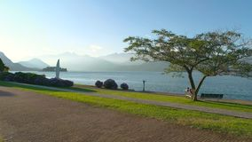 Lake Maggiore scenery, sunny day. Beautiful park near the water stock footage