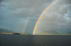 Lake Maggiore under the rainbow. The Northern Italian Lake Maggiore under a double rainbow stock images
