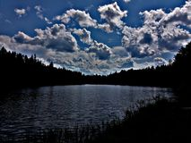 Lake. Maine trees forest northwoods sunset sunrise clouds sky field lake water stock image