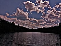 Lake. Maine trees forest northwoods sunset sunrise clouds sky field lake water royalty free stock photos