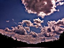 Lake. Maine trees forest northwoods sunset sunrise clouds sky field lake water royalty free stock image