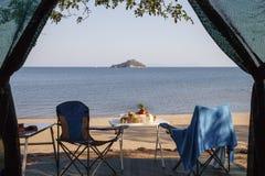 Lake Malawi. Idyllic scene of camping on lake Malawi, with an island in the distance Stock Photo