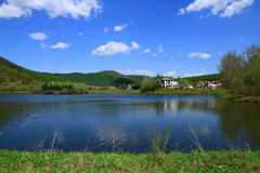 Yuanyang Lake — Mudanfeng. Seeing the blue water and sky bring us with the utmost visual enjoyment Royalty Free Stock Image
