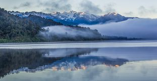 Lake Mapourika. Reflection Of Southern Alps In Calm Water Of Lake Mapourika, Westland Tai Poutini National Park, West Coast, South Island, New Zealand Stock Photography