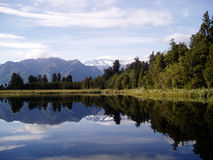 Lake Matheson. South Island, New Zealand with the Southern Alps, Mt Cook and Mt Tasman in the background and reflection Stock Images