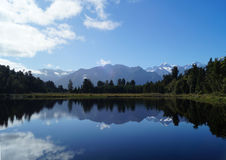 Lake Matheson MOUNTAIN REFLECTION. View of Mount Cook and the Southern Alps across Lake Matheson in New Zealand Royalty Free Stock Images
